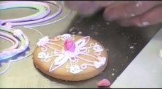 David decorates a cookie with royal icing Kelmy
